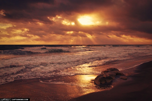 Sun Rays Through the Clouds Over the Ocean at Beach